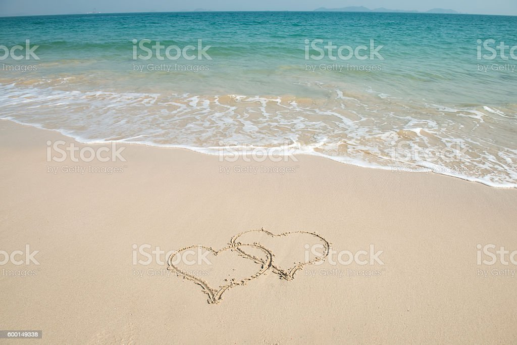 two hearts in sand on a beautiful beach stock photo