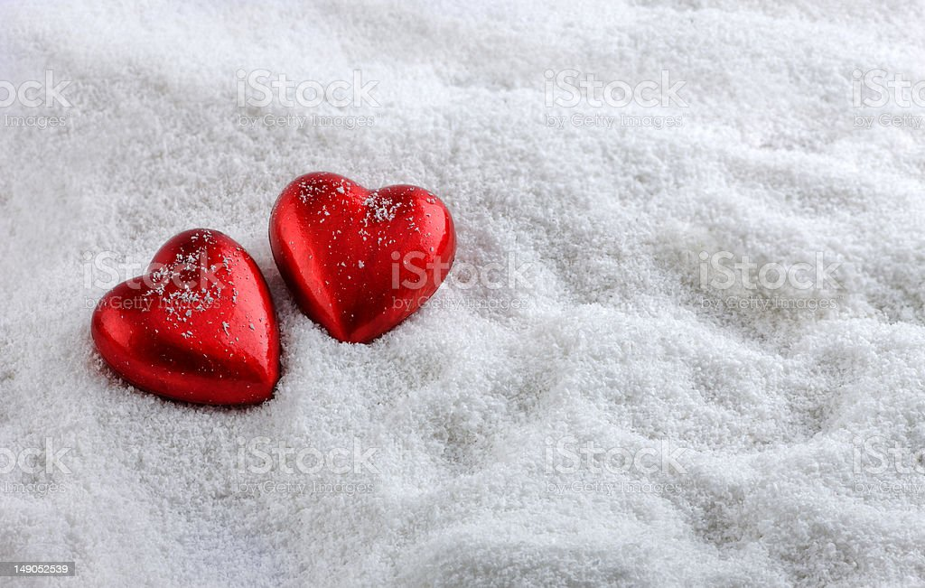 Two hearts in the snow royalty-free stock photo