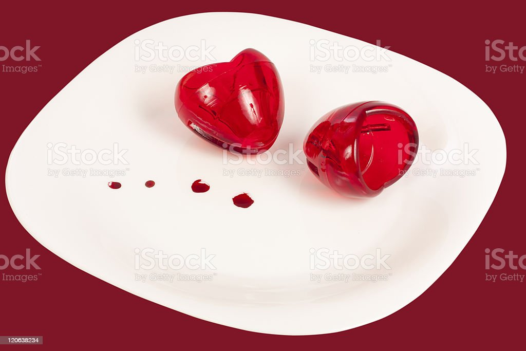 Two hearts of glass on a plate royalty-free stock photo
