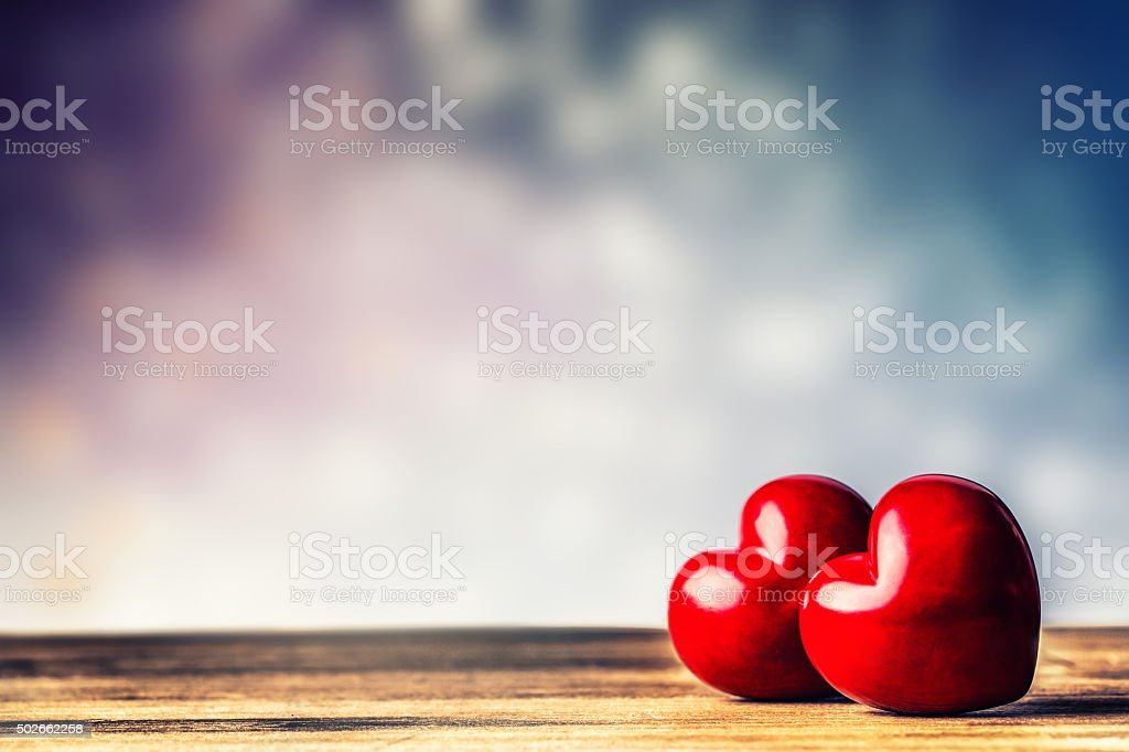 Two Hearts on a wooden board. Valentine's Day. Valentine's Greeting stock photo