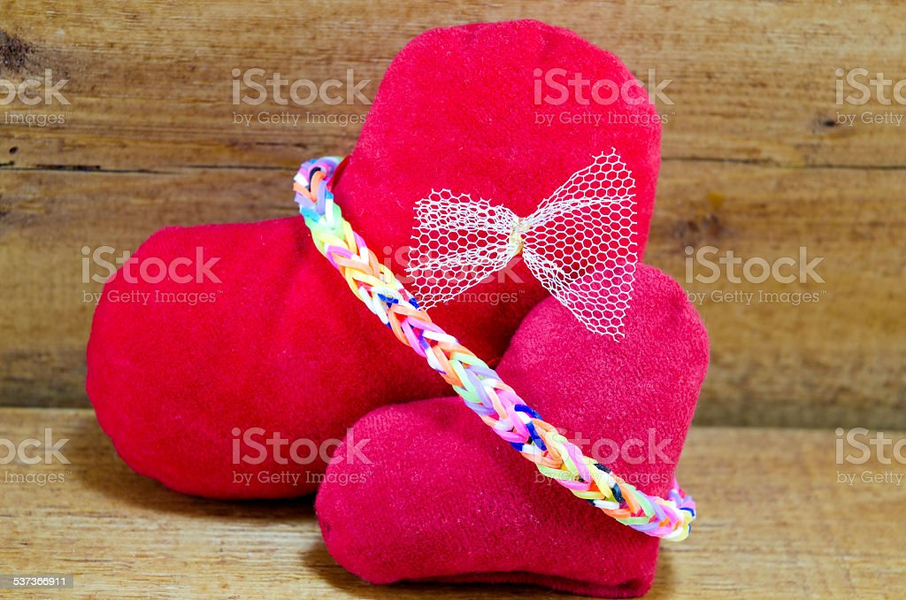 Two hearts on a wooden surface royalty-free stock photo