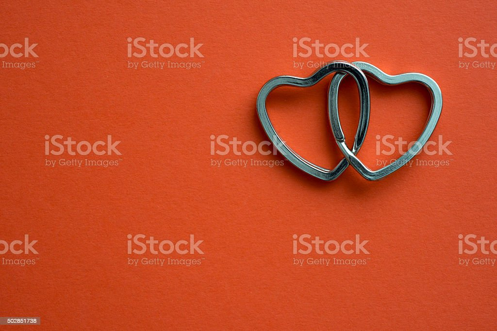 two hearts on red stock photo