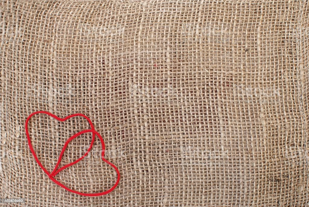 Two hearts on sackcloth background royalty-free stock photo