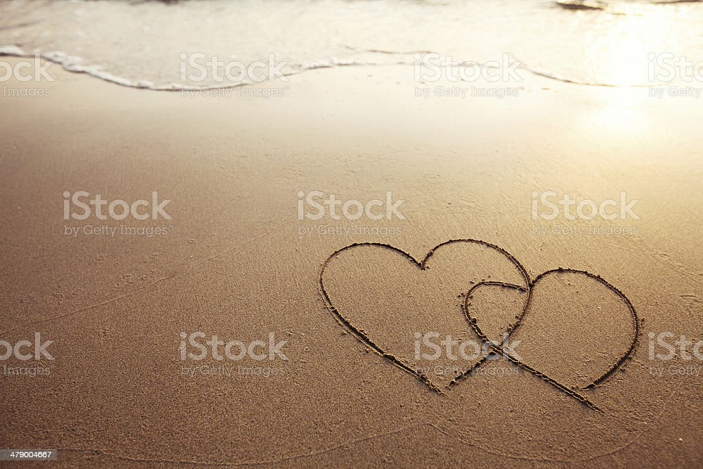 two hearts on the beach stock photo