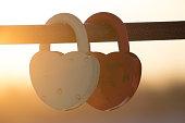 two heart-shaped padlocks