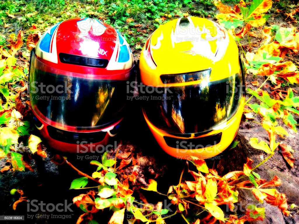 two helmets of motorcyclists stock photo