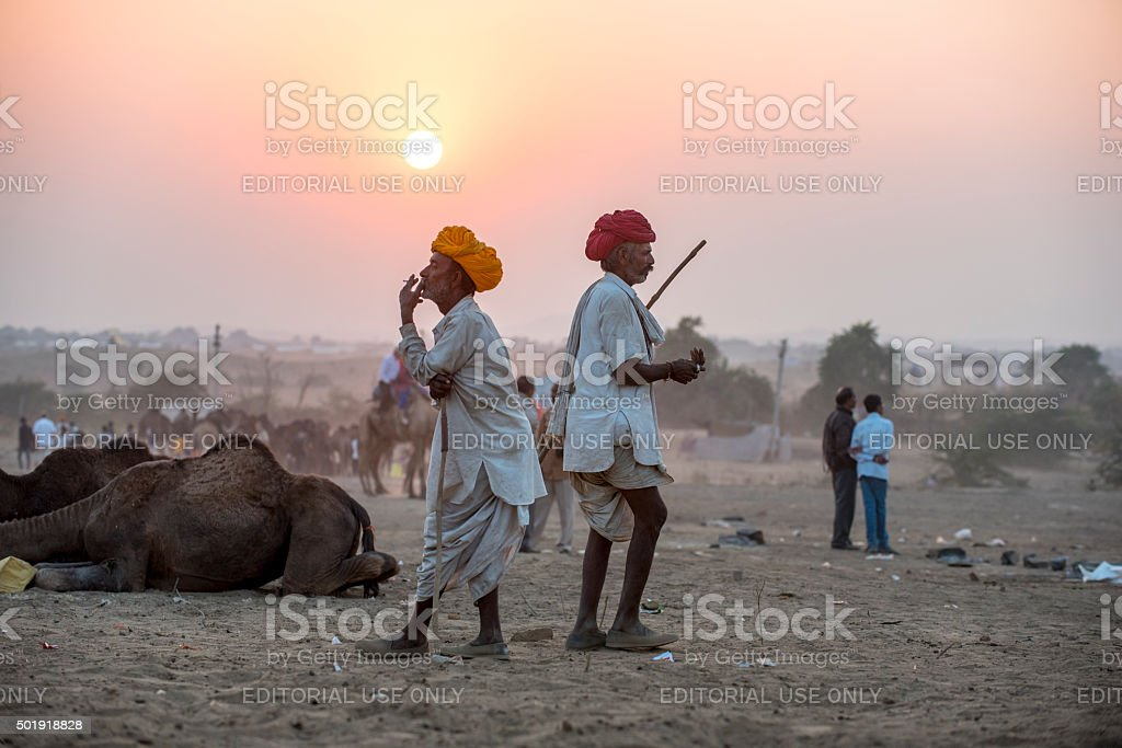 Two herdsman standing in front of Camel Fairs, India stock photo