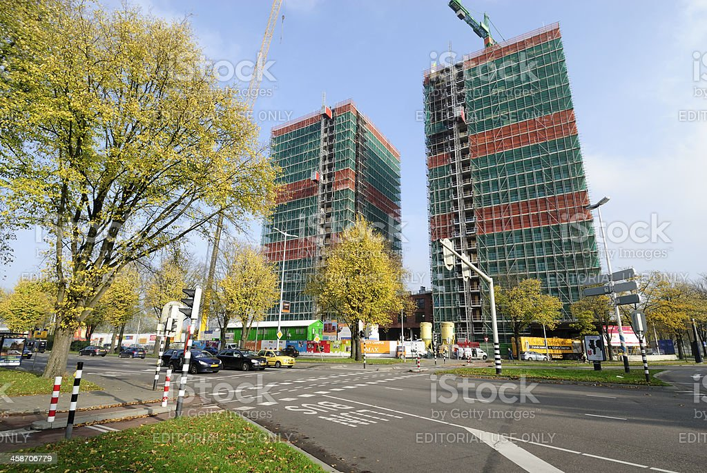 Two highrise apartment buildings under construction royalty-free stock photo