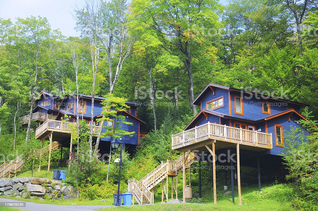 Two Highrise Blue Mountainside Chalets royalty-free stock photo
