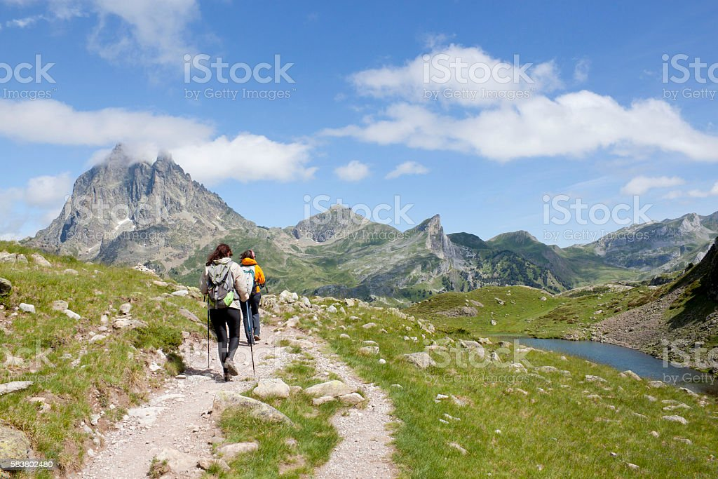 two hiker in front of the Midi d'Ossau stock photo