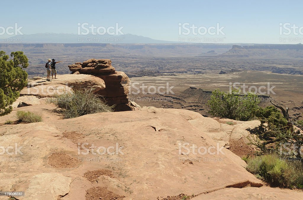 Two Hikers at Canyonlands royalty-free stock photo
