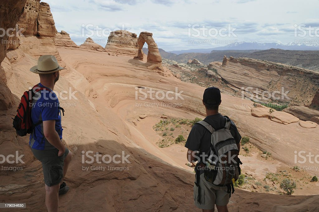 Two Hikers at Delicate Arch royalty-free stock photo
