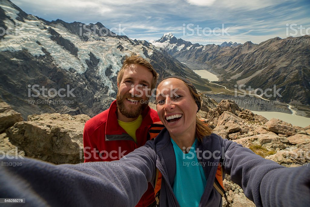 Two hikers capturing achievement stock photo