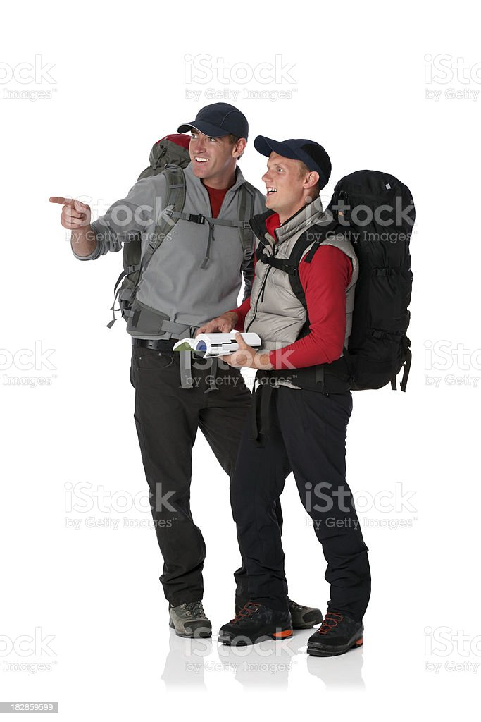 Two hikers carrying backpacks and smiling royalty-free stock photo
