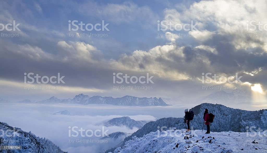 Two Hikers in Mountain Niubeishan Looking at View royalty-free stock photo