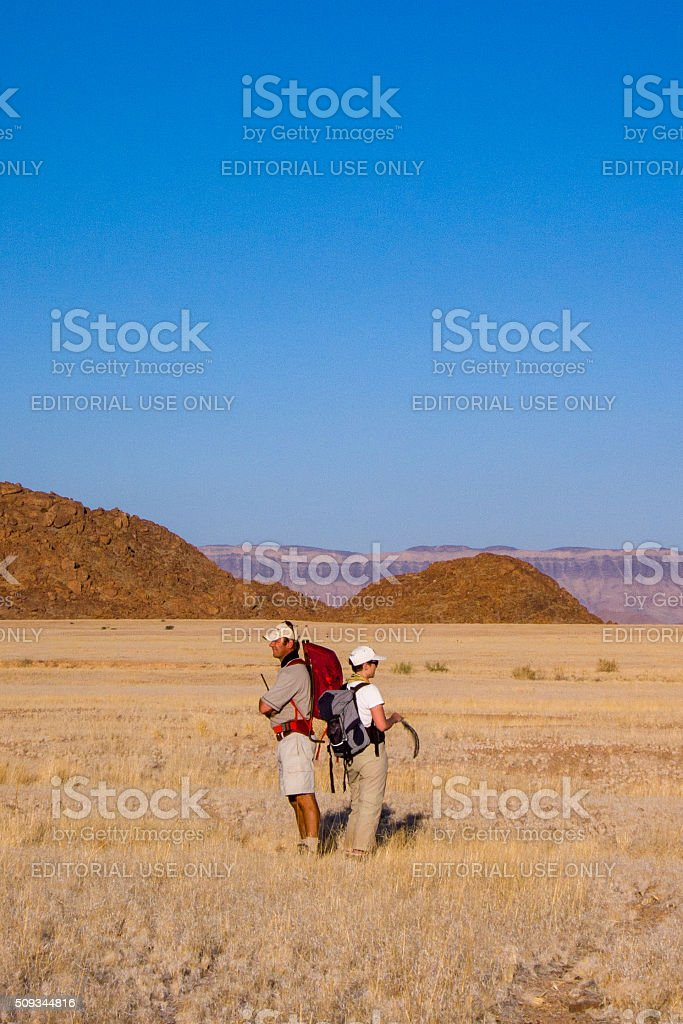 Two Hikers in the prairie stock photo