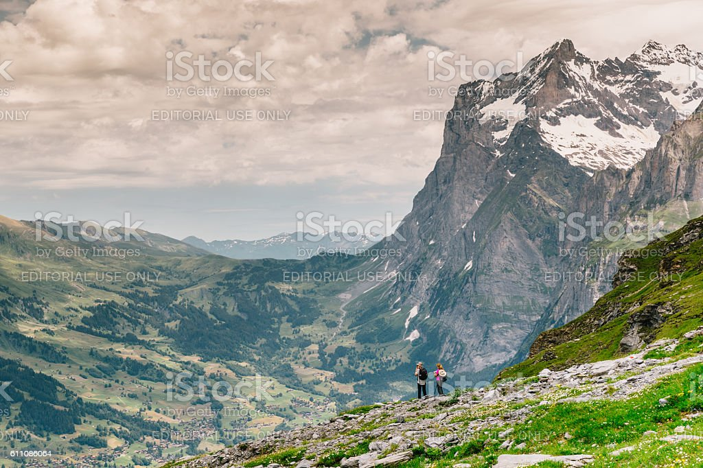 Two hikers on Eiger Trail, Switzerland stock photo