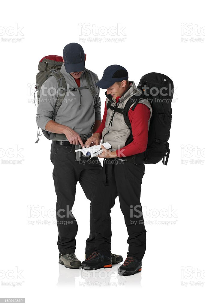 Two hikers reading book royalty-free stock photo