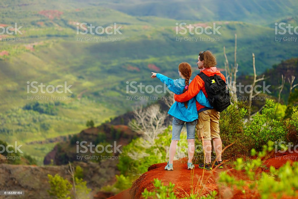 Two hikers relaxing enjoying the amazing view stock photo