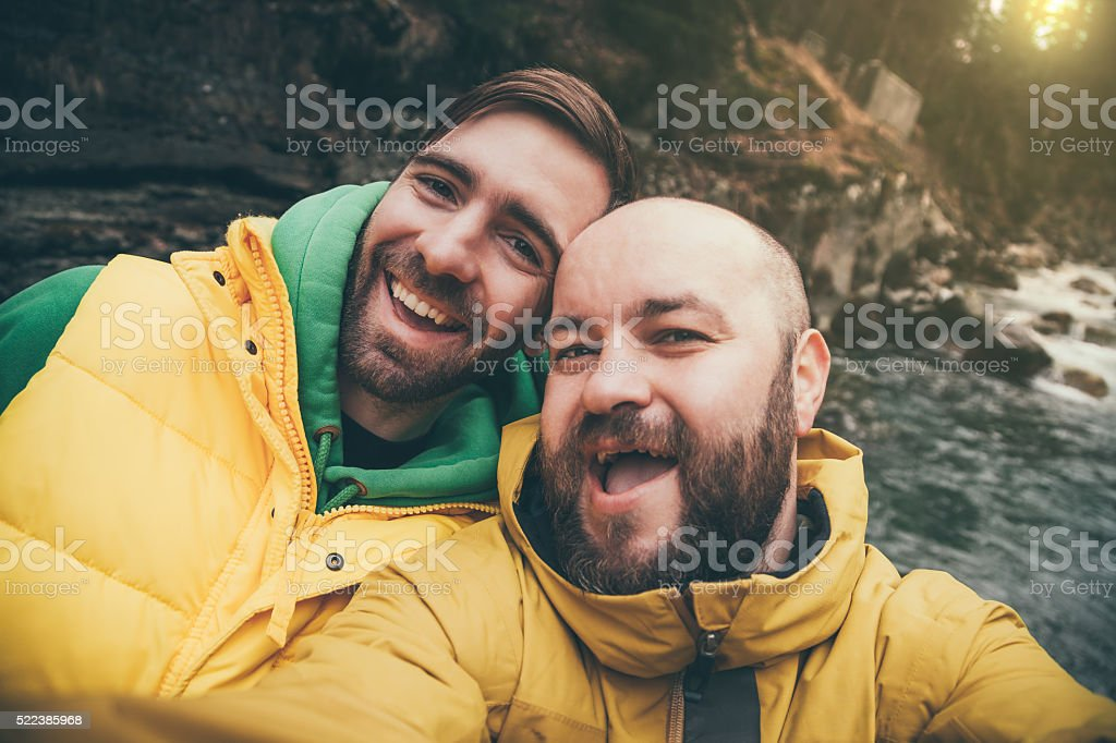 Two hikers taking selfie in mountains stock photo