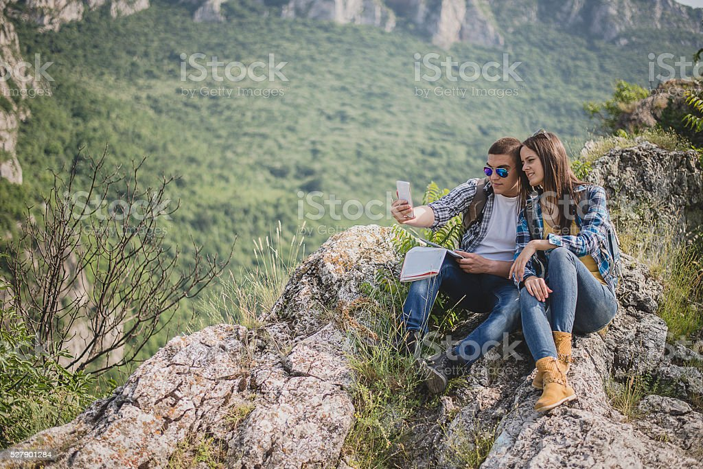 Two hikers taking selfie stock photo