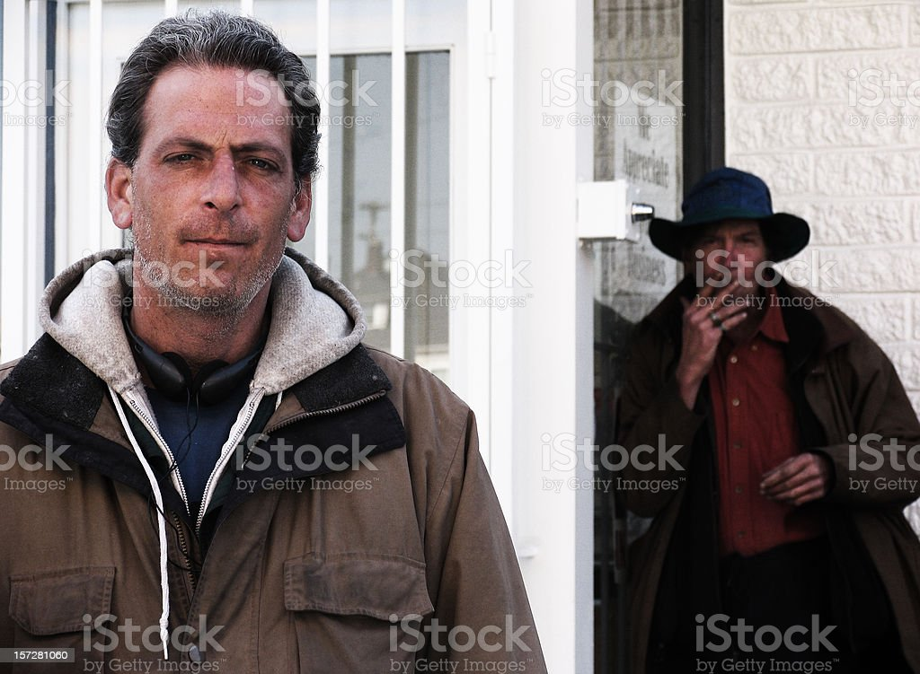 Two Homeless Men Being Lazy Outside royalty-free stock photo