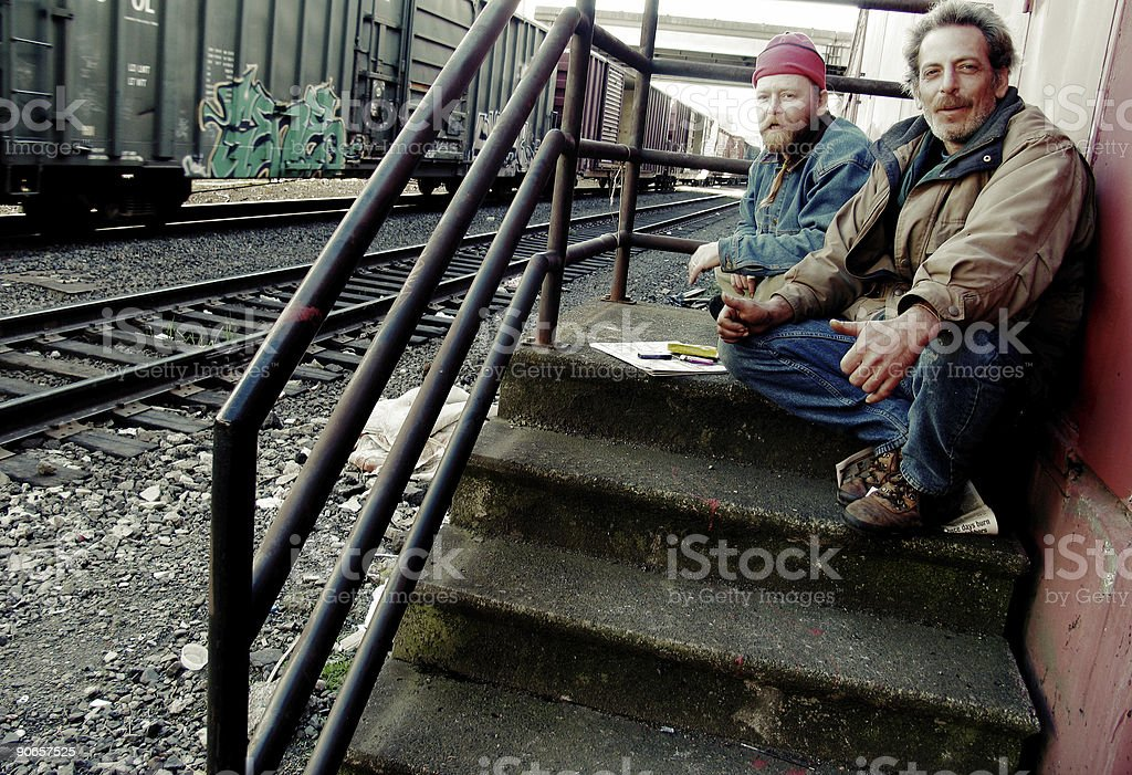 Two Homeless Men Sitting on Stairs royalty-free stock photo