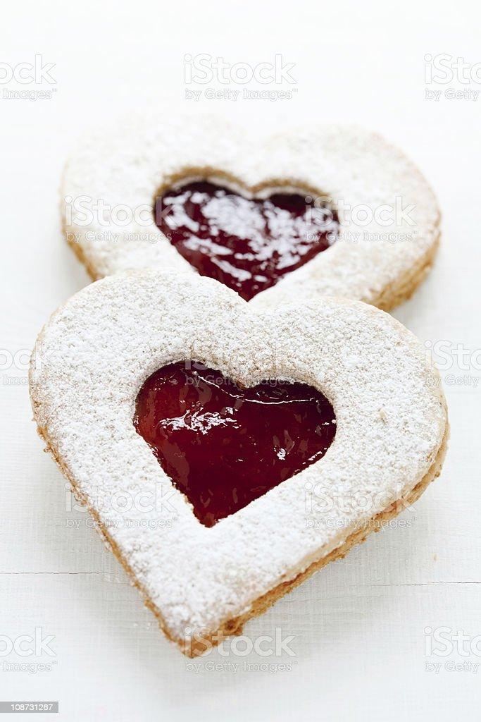 two homemade linzer cookies with heart shape stock photo
