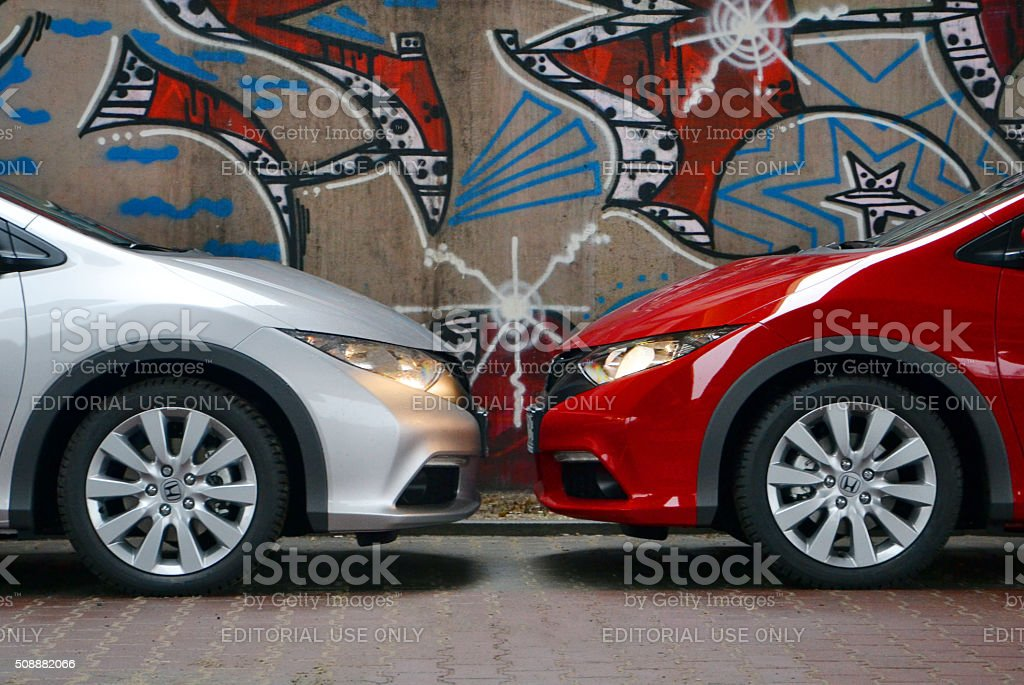 Two Honda Civic cars stopped opposite each other stock photo