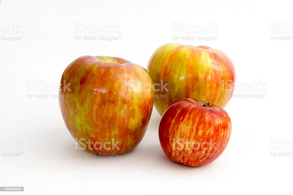 Two honeycrisp and a Jonathan apple against white stock photo