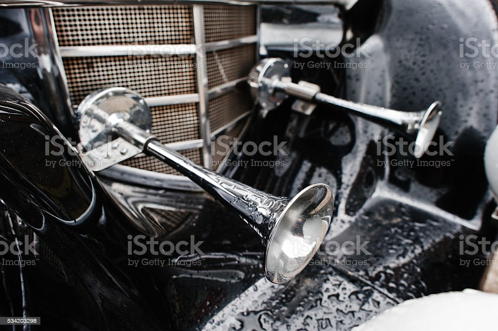 Two horns at old vintage retro car stock photo