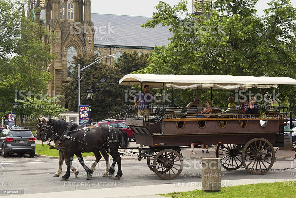 Two horse carriage with tourists in Charlottetown in Canada stock photo