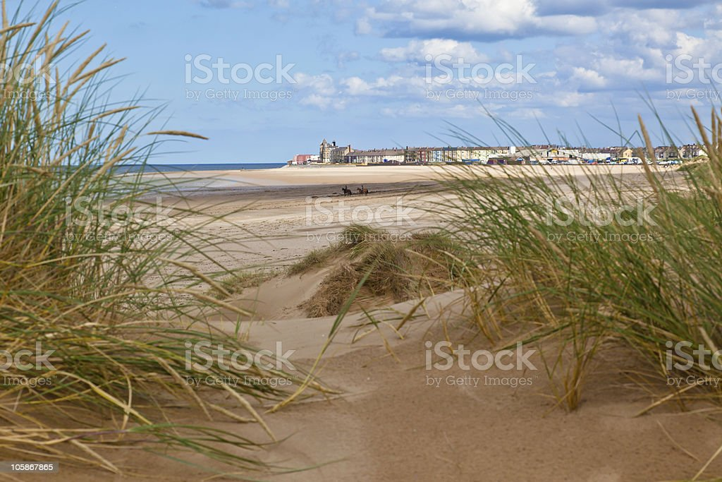 Two horse riders on Redcar beach stock photo