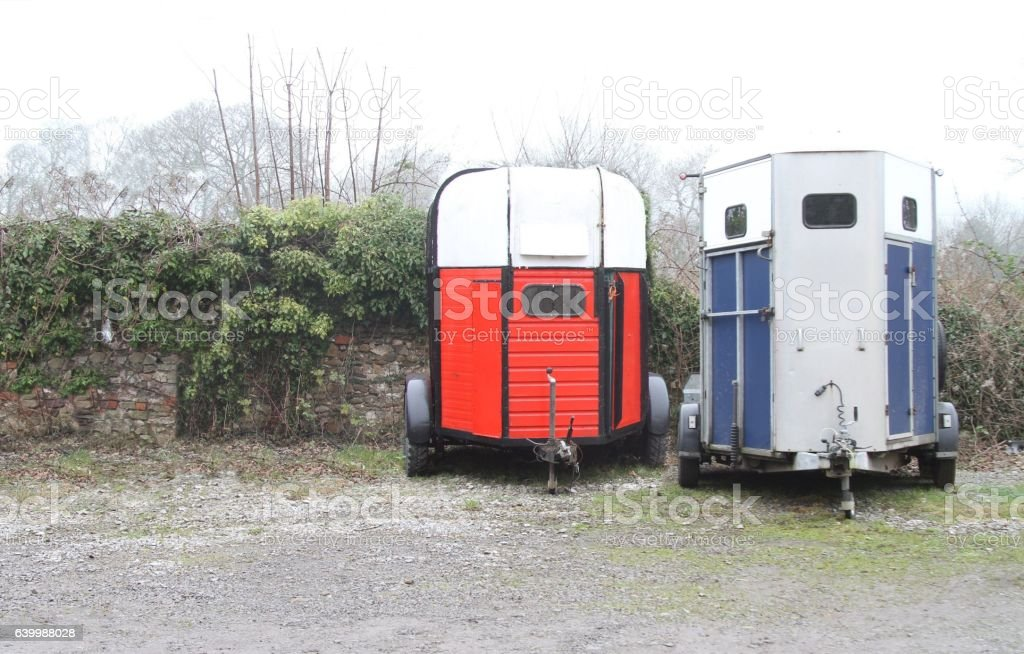 Two horse transport trailers stock photo