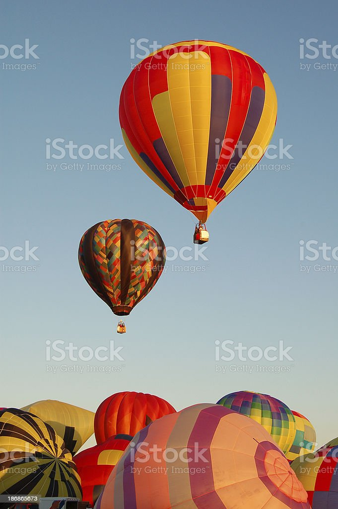 Two Hot Air Balloons Lifting Off royalty-free stock photo