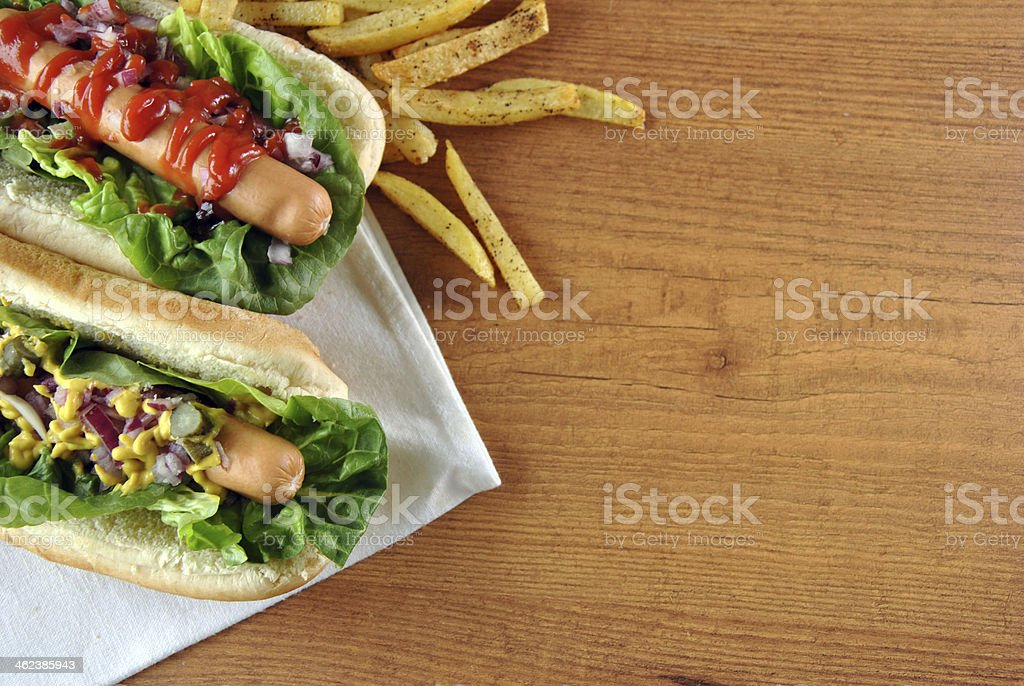 two hot dogs with salad stock photo