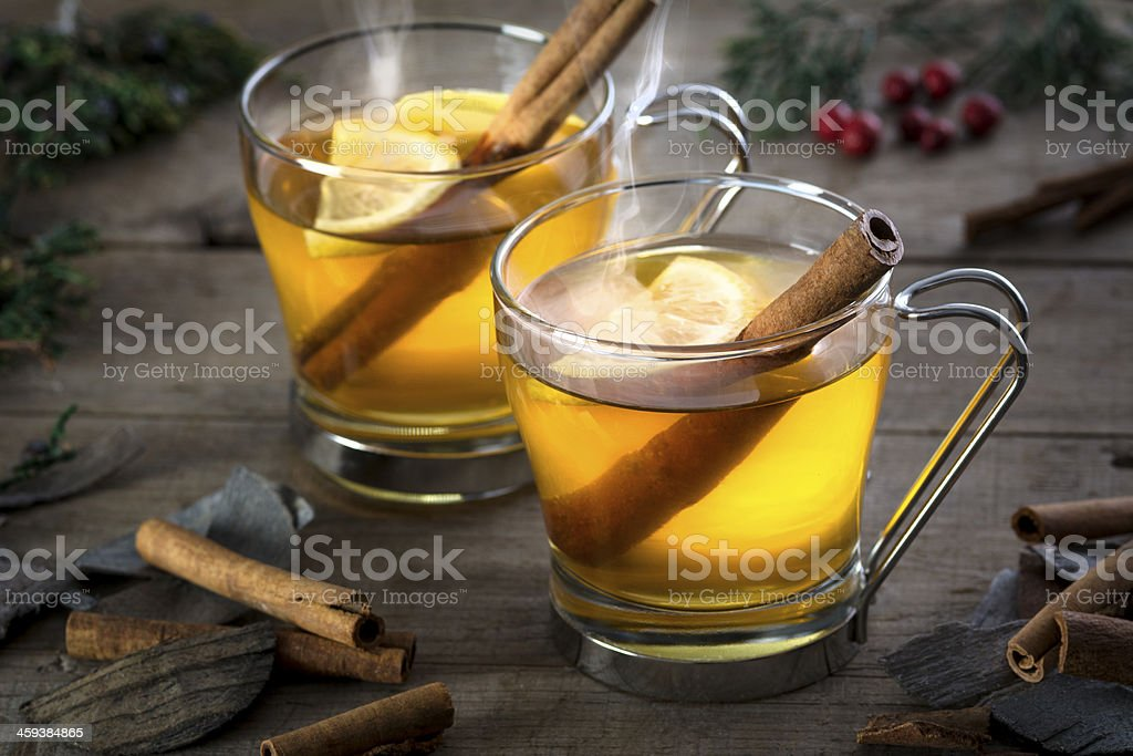 Two Hot Toddy Cocktail Drinks with Cinnamon and Lemmon stock photo