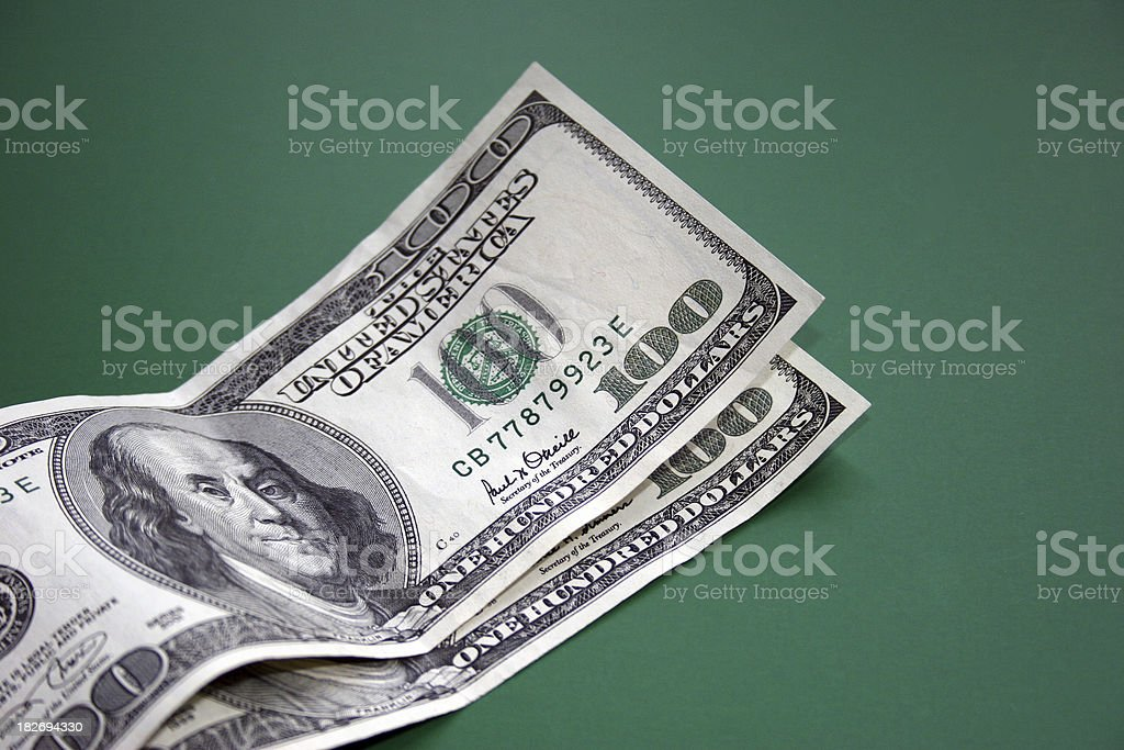 Two Hundred Dollar Bills on Green stock photo
