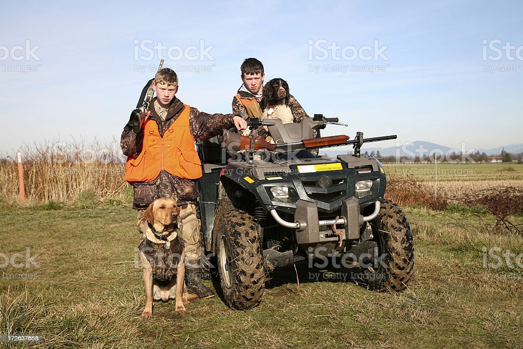 Two hunters and their dogs stock photo