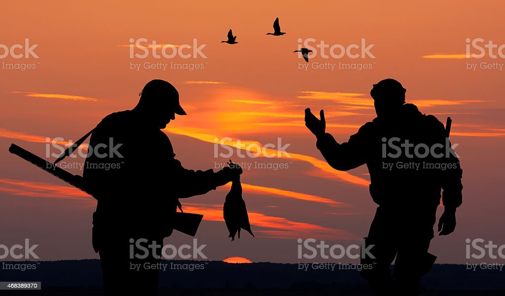 two hunters at sunset vector art illustration