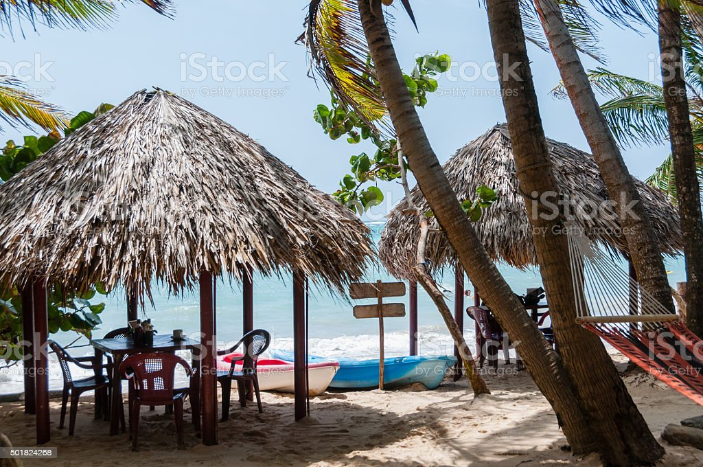 Two Huts With Tables Chairs and Hammock at the white stock photo