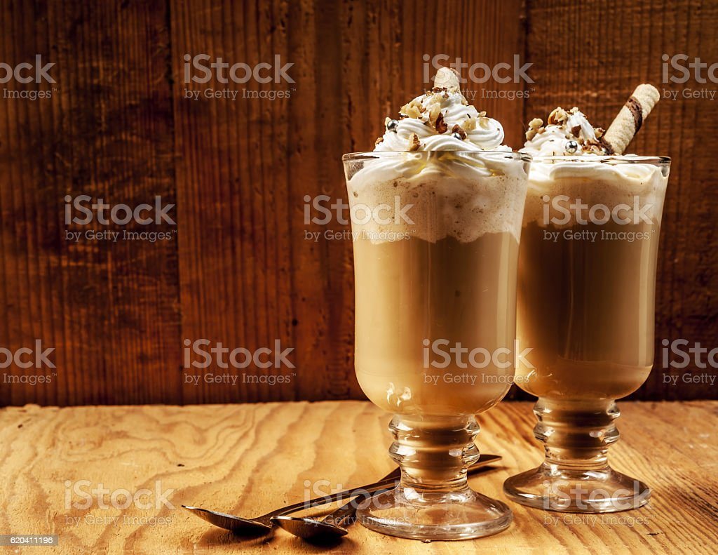 two ice coffees on wooden background stock photo