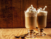 two ice coffees on wooden background