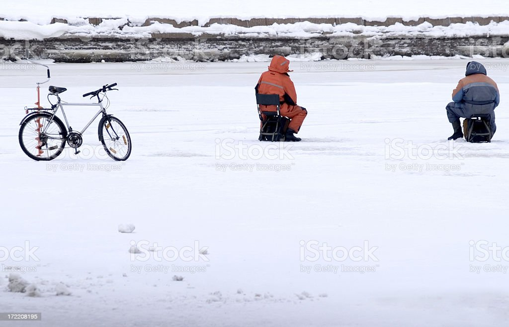 Two ice fishermen and bicycle with copy space royalty-free stock photo