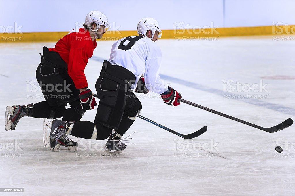 Two Ice Hockey Players Duelling royalty-free stock photo