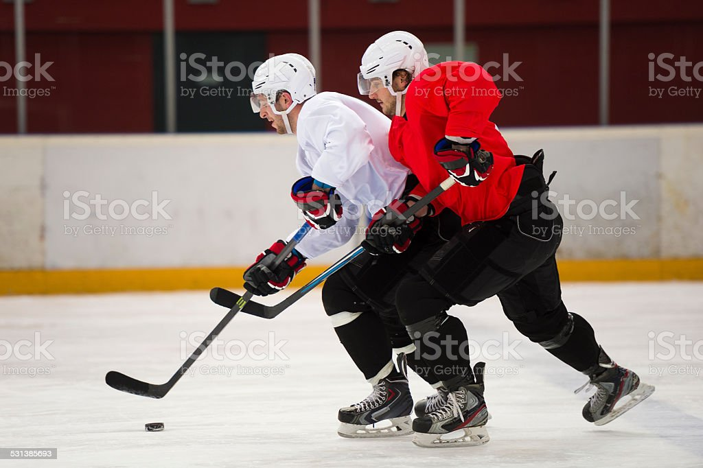 Two Ice Hockey Players Duelling stock photo