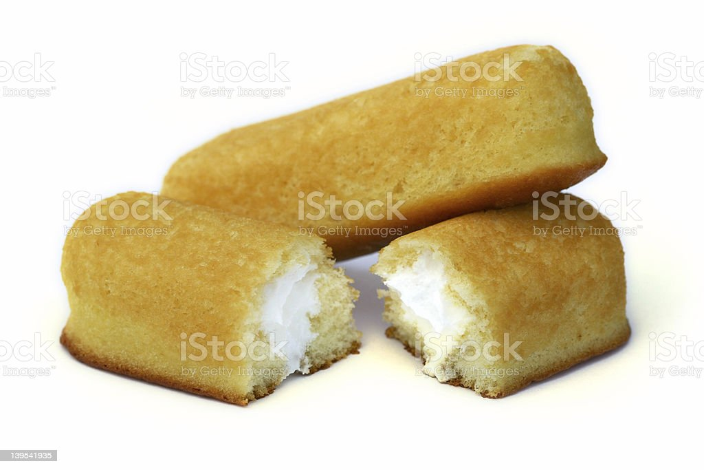 two icing filled yellow cake rolls royalty-free stock photo