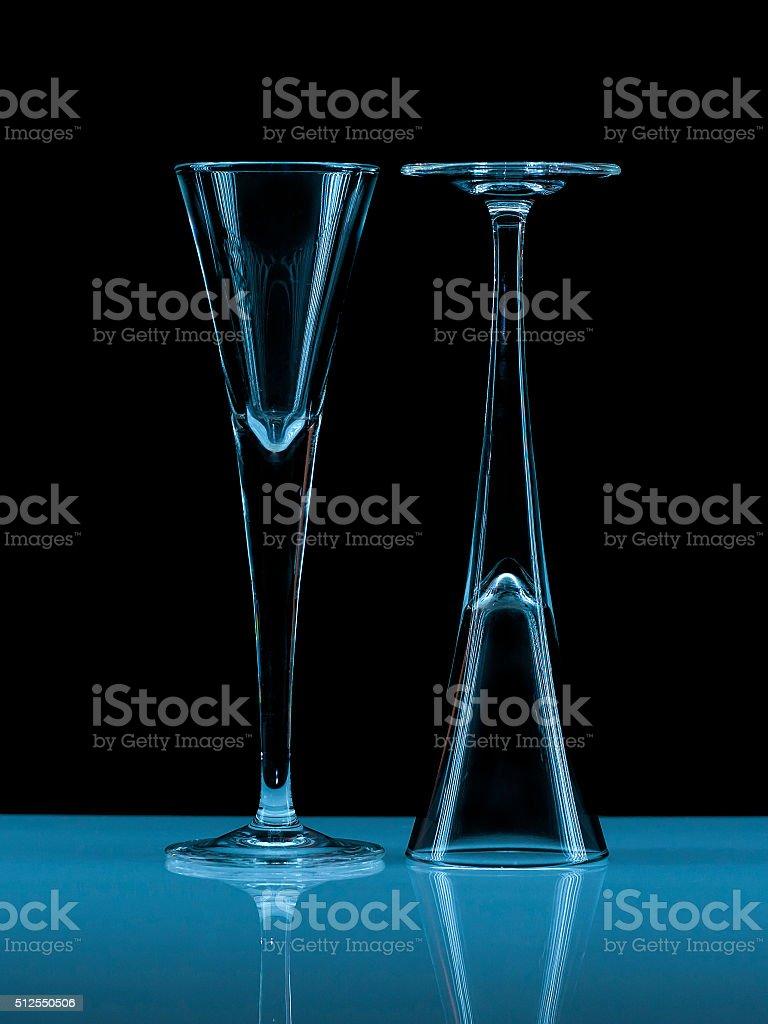 Two illuminated liqueur glasses stock photo