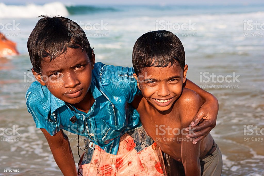 Two Indian boys on the beach stock photo