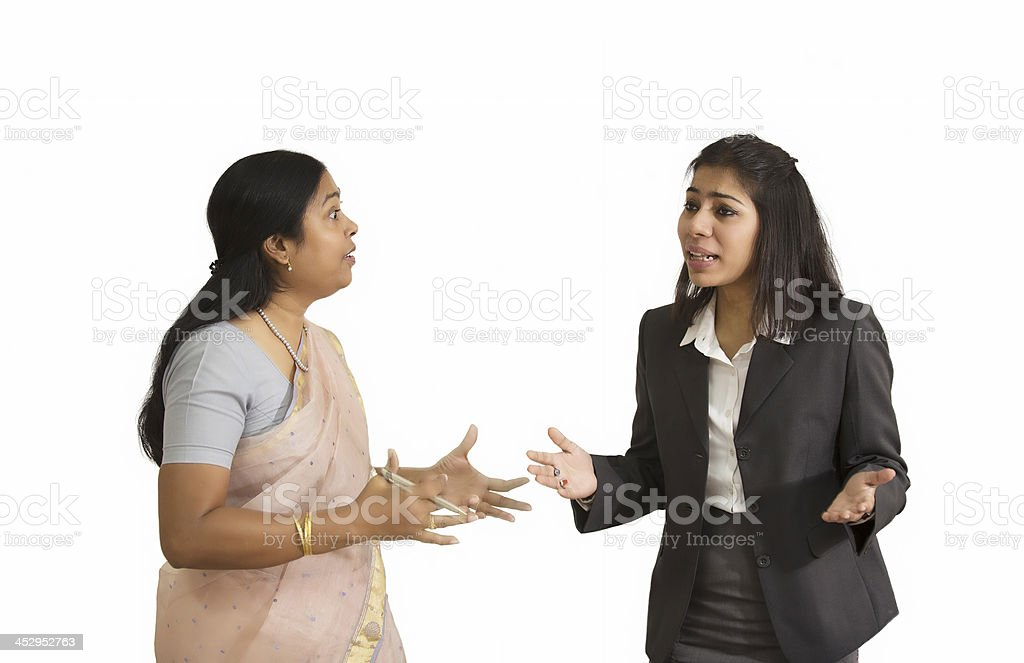 Two Indian Businesswoman fighting and arguing royalty-free stock photo